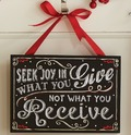 Seek_joy_plaque