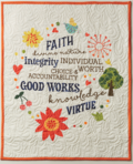 Young women values hanging quilt